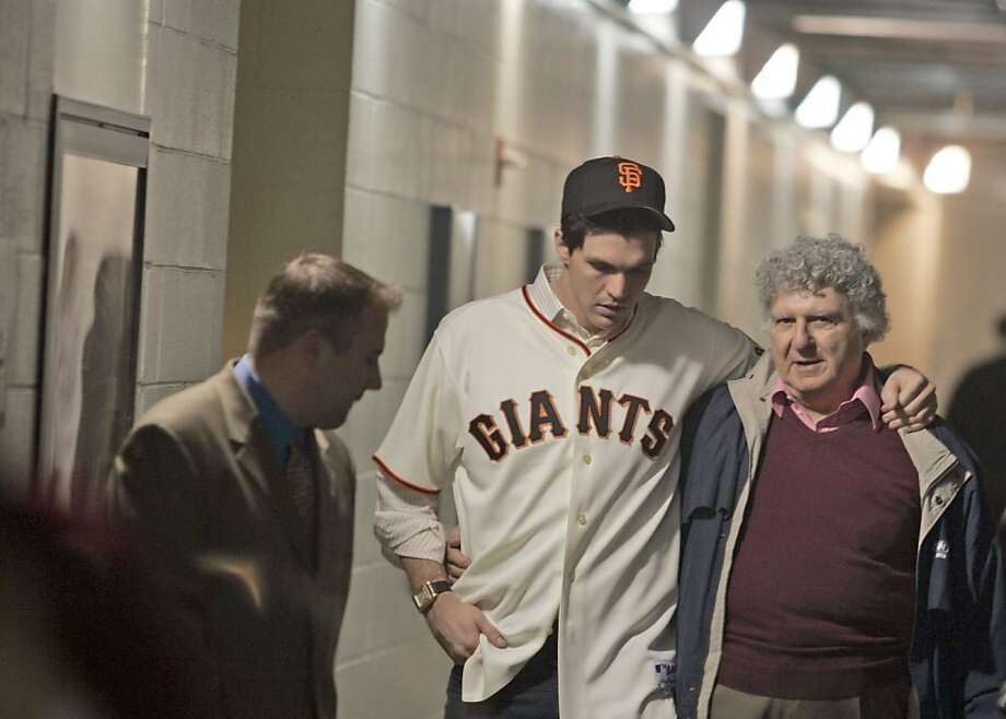 Barry Zito walks arm-in-arm with his father, Joe, after meeting with the media when he joined the Giants in 2007. Photo: By Lance Iversen, SFC