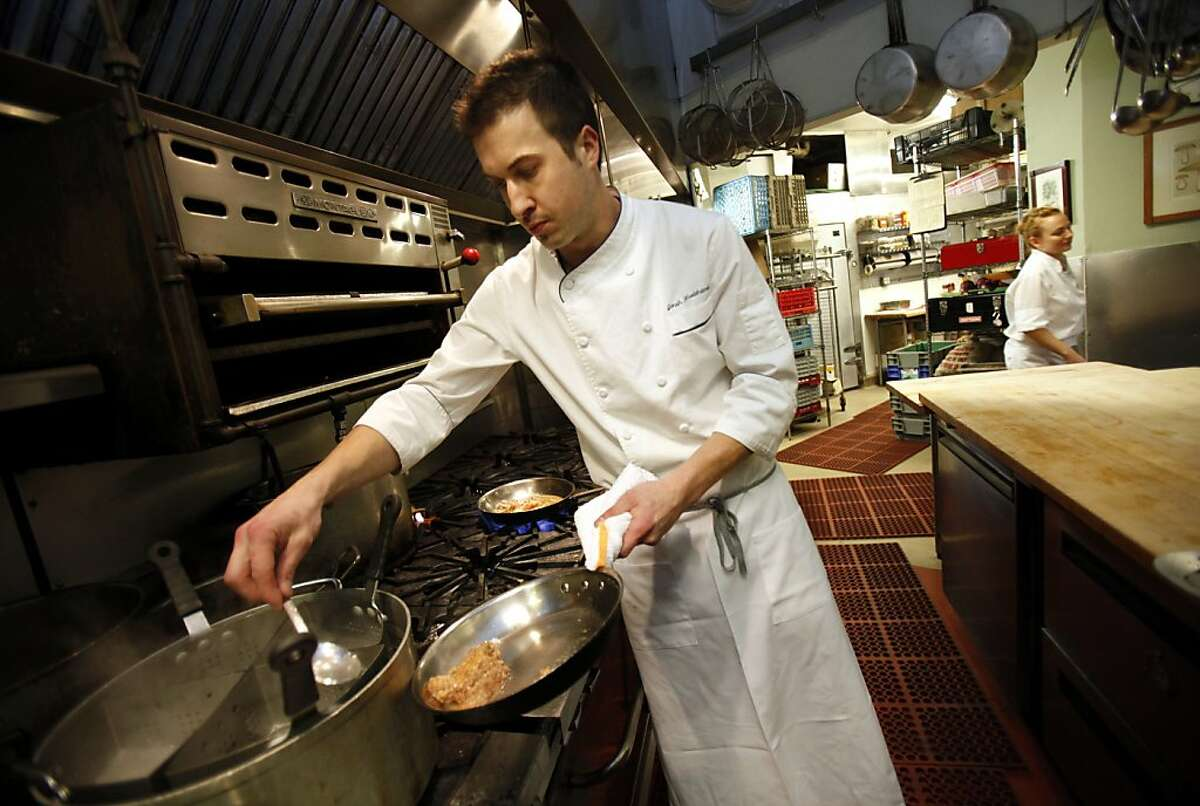 Jonah Rhodehamel, the executive chef at Oliveto, prepares homemade pasta at the restaurant in Oakland, Calif., Thursday, December 29, 2011. The restaurant uses California-grown heirloom wheat and grains to make many of the pastas it features regularly.