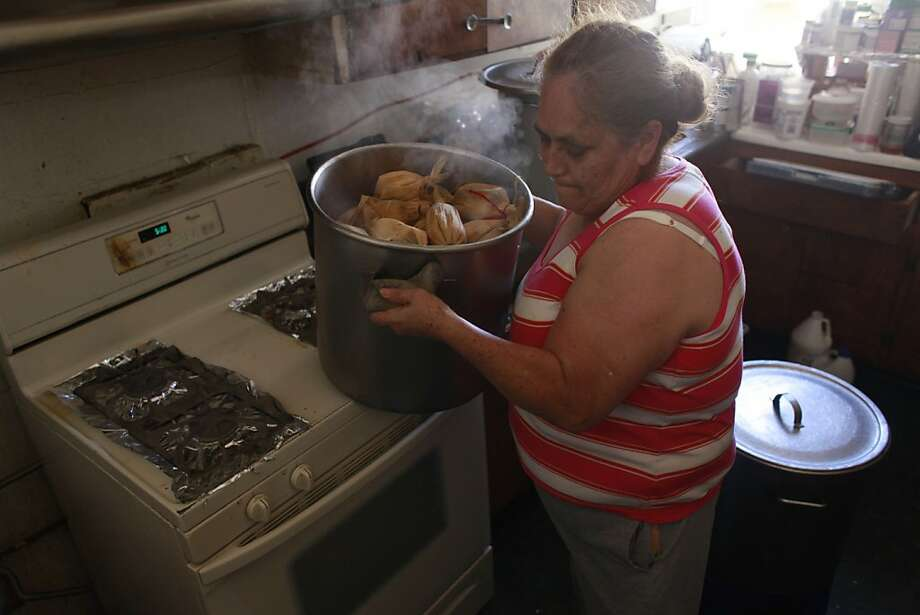 Just as she has been doing for over 20 years, Virginia Ramos, a.k.a. The Tamale Lady, takes a fresh batch of tamales, that she will later pedal inside local businesses, off the stove in her kitchen on Tuesday June 12, 2012 in San Francisco, Calif. It may be easier for Ramos to operate now after, Supervisor Scott Wiener introduced legislation, during Tuesday's Board of Supervisors meeting, repealing various Police Code sections that are outdated and serve no apparent purpose other than to trigger significant penalties. including: --Repealing a prohibition on selling food or drink on the premises of businesses where food and drink is served even with the business owner's permission. Photo: Mike Kepka, The Chronicle