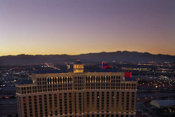 FOR IMMEDIATE RELEASE--The fountains of the Bellagio Hotel and Casino are seen from the Paris Hotel and Casino's Eiffel Tower at sunset in Las Vegas, Jan. 18, 2002. The view of the fountains from the tower is considered one of the most romantic in Las Vegas.
