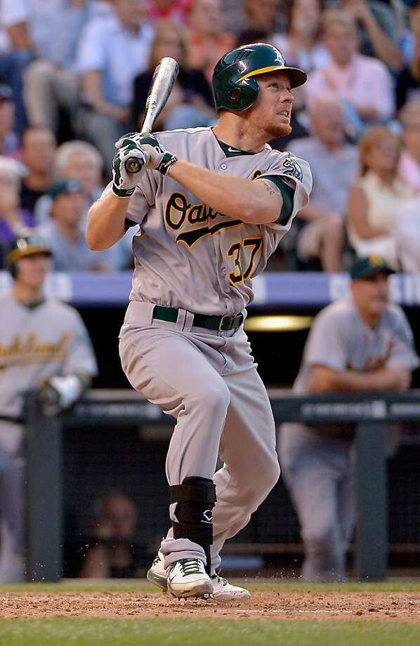 DENVER, CO - JUNE 12:  Brandon Moss #37 of the Oakland Athletics watches his two run home run off of starting pitcher Jeremy Guthrie #15 of the Colorado Rockies to give the A's a 5-4 lead in the third inning during Interleague Play at Coors Field on June 12, 2012 in Denver, Colorado.  (Photo by Doug Pensinger/Getty Images) Photo: Doug Pensinger, Getty Images