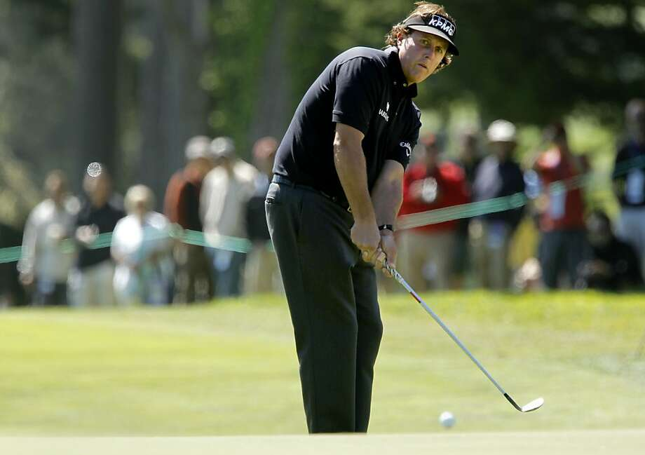 Phil Mickelson chips to the par-3 seventh hole, as the second day of practice rounds continue during the United States Open Championship at the Olympic Club in San Francisco, Ca., on Tuesday June 12, 2012. Photo: Michael Macor, The Chronicle