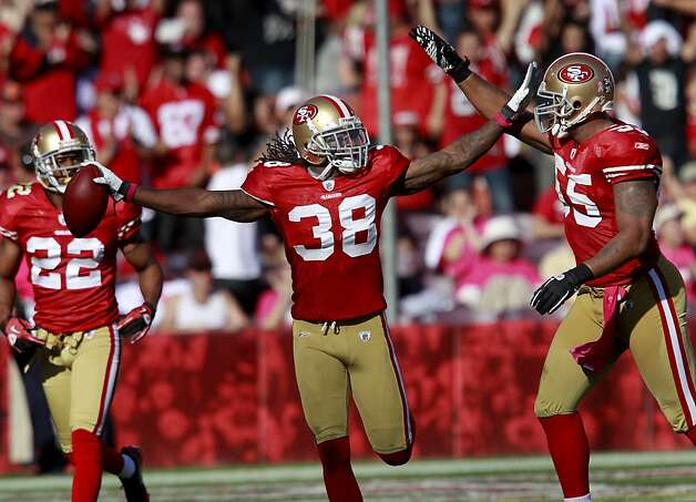 49ers safety Dashon Goldson celebrated his third quarter interception in the endzone with other players. The San Francisco 49ers defeated the Cleveland Browns 20-10 at Candlestick Park Sunday October 30, 2011. Photo: Brant Ward, The Chronicle