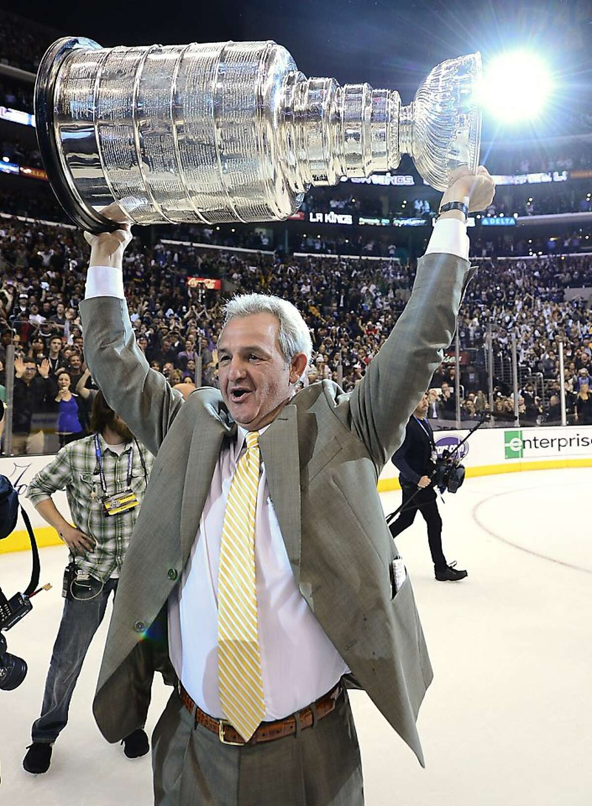 Los Angeles Kings coach Darryl Sutter hoists the Stanley Cup after beating the New Jersey Devils 6-1 during Game 6 of the NHL hockey Stanley Cup finals, Monday, June 11, 2012, in Los Angeles. (AP Photo/Mark J. Terrill)