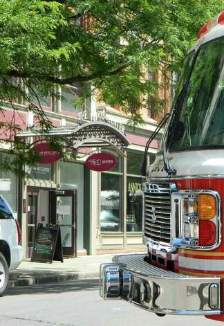 A city of Troy fire truck sits outside the Capital Region Center for the Arts on Wednesday, June 13, 2012, in Troy, N.Y. Eight people were trapped in the building's elevator earlier in the morning but were freed without injury after roughly 90 minutes. (Matthew Hamilton/Special to the Times Union) Photo: Matthew Hamilton