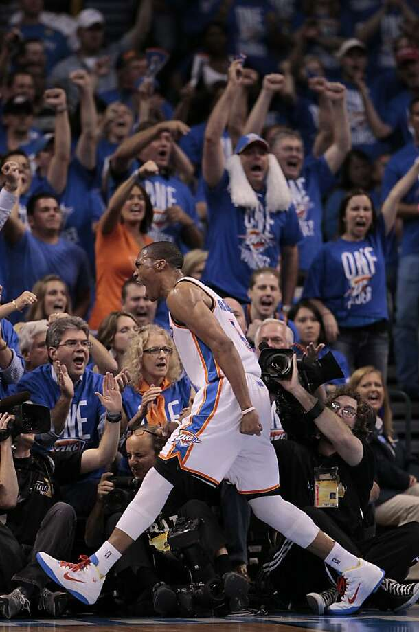 Oklahoma City Thunder point guard Russell Westbrook reacts against the Miami Heat during the second half at Game 1 of the NBA finals basketball series, Tuesday, June 12, 2012, in Oklahoma City. (AP Photo/Jeff Roberson) Photo: Jeff Roberson, Associated Press