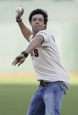 Golfer Rory McIlroy, of Northern Ireland, throws out the ceremonial first pitch before a baseball game between the San Francisco Giants and the Houston Astros in San Francisco, Tuesday, June 12, 2012. (AP Photo/Jeff Chiu)