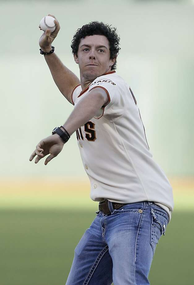 Golfer Rory McIlroy, of Northern Ireland, throws out the ceremonial first pitch before a baseball game between the San Francisco Giants and the Houston Astros in San Francisco, Tuesday, June 12, 2012. (AP Photo/Jeff Chiu) Photo: Jeff Chiu, Associated Press