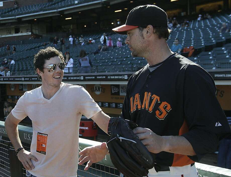 Golfer Rory†McIlroy, left, of Northern Ireland, talks with San Francisco Giants pitcher Ryan Vogelsong before a baseball game between the Giants and the Houston Astros in San Francisco, Tuesday, June 12, 2012. McIlroy will throw out the ceremonial first pitch. (AP Photo/Jeff Chiu) Photo: Jeff Chiu, Associated Press