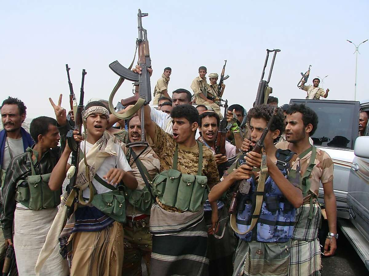 In this handout photo provided by the Yemen Defense Ministry, Yemeni army soldiers and tribesmen loyal to the army celebrate after they retook the city of Zinjibar from al-Qaida militants, in the city of Zinjibar, Yemen, Tuesday, June 12, 2012. Yemeni troops backed by armed tribesmen routed al-Qaida on Tuesday from two southern strongholds the terror network had held for more than a year, the most significant victory so far in a monthlong offensive against a local franchise that has tried time and again to bomb U.S.-bound planes. (AP Photo/Yemen Defense Ministry)