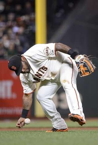 SAN FRANCISCO, CA - JUNE 12:  Pablo Sandoval #48 of the San Francisco Giants can't field the bunt cleanly that goes for a base hit off the bat of Matt Downs #16 of the Houston Astros in the seventh inning at AT&T Park on June 12, 2012 in San Francisco, California.  (Photo by Thearon W. Henderson/Getty Images) Photo: Thearon W. Henderson, Getty Images