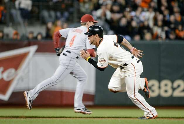 SAN FRANCISCO, CA - JUNE 12:  Gregor Blanco #7 of the San Francisco Giants steals second base and takes off for third when the throw goes into center field in the seventh inning against the Houston Astros at AT&T Park on June 12, 2012 in San Francisco, California.  (Photo by Thearon W. Henderson/Getty Images) Photo: Thearon W. Henderson, Getty Images