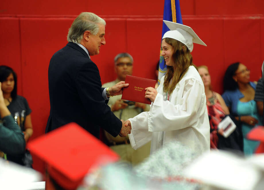 Superintendent of Schools Dr. Stephen Tracy hands out diplomas during Derby High School's Class of 2012 Commencement Ceremony in Derby, Conn. on Tuesday June 12, 2012. Photo: Christian Abraham / Connecticut Post