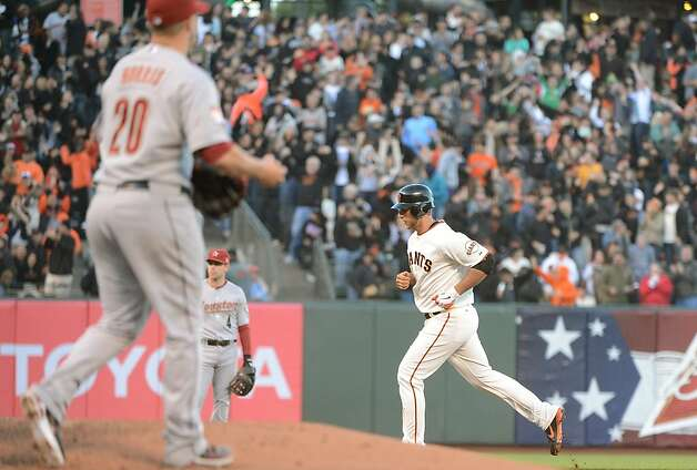 SAN FRANCISCO, CA - JUNE 12:  Madison Bumgarner #40 of the San Francisco Giants trots around the bases after hitting a solo home run as Bud Norris #20 of the Houston Astros looks on in the third inning at AT&T Park on June 12, 2012 in San Francisco, California.  (Photo by Thearon W. Henderson/Getty Images) Photo: Thearon W. Henderson, Getty Images