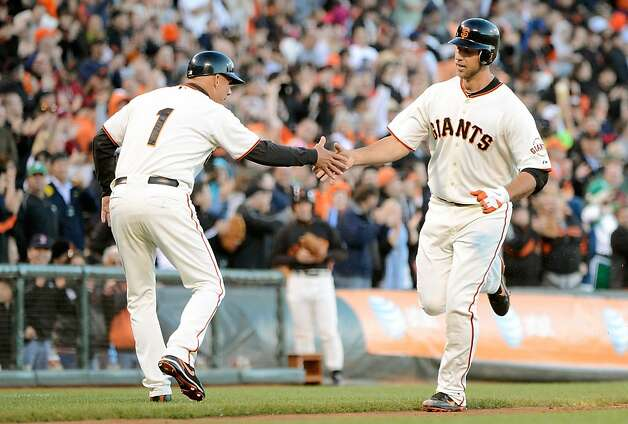 SAN FRANCISCO, CA - JUNE 12:  Madison Bumgarner #40 of the San Francisco Giants rounds third base and slaps hands with third base coach Tim Flannery #1 after hitting a solo home run against the Houston Astros in the third inning at AT&T Park on June 12, 2012 in San Francisco, California.  (Photo by Thearon W. Henderson/Getty Images) Photo: Thearon W. Henderson, Getty Images