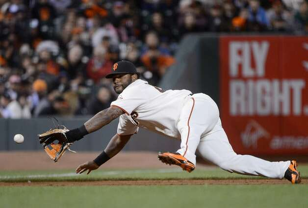 SAN FRANCISCO, CA - JUNE 12:  Pablo Sandoval #48 of the San Francisco Giants dives to his right to catch a line-drive, taking away a hit from Brian Bixler #12 of the Houston Astros in the six inning at AT&T Park on June 12, 2012 in San Francisco, California.  (Photo by Thearon W. Henderson/Getty Images) Photo: Thearon W. Henderson, Getty Images