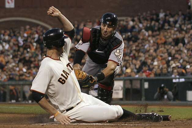 Houston Astros catcher Jason Castro, rear, tags out San Francisco Giants' Brandon Belt during the fourth inning of a baseball game in San Francisco, Tuesday, June 12, 2012. (AP Photo/Jeff Chiu) Photo: Jeff Chiu, Associated Press
