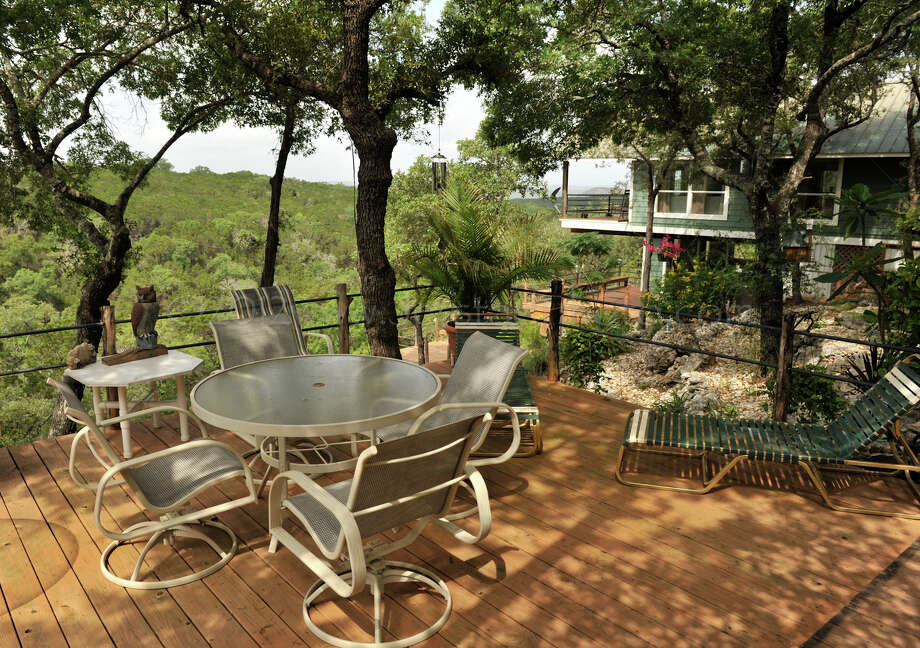 SLUG: RE spaces Boessling 0617-Photo Request number 57645-June 12, 2012-Canyon Lake, Texas-One of the numerous decks at the Canyon Lake area home of Sonny and Linda Boessling. Photo: Robin Jerstad