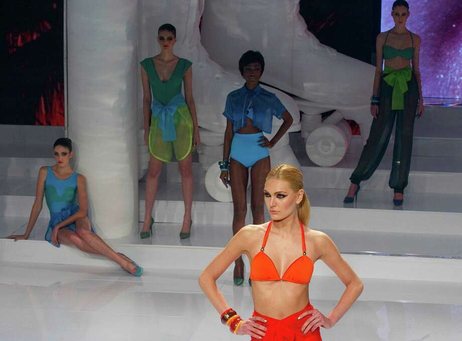 Models wear creations from the O Boticario summer collection during Sao Paulo Fashion Week events in Sao Paulo, Brazil, Wednesday, June 13, 2012. (AP Photo/Andre Penner) Photo: Andre Penner, Associated Press / AP
