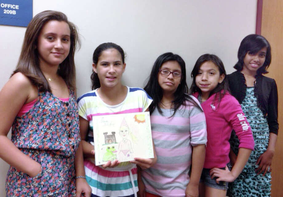 From the left, Mirian Aravjo, Teresa Coakley, Daisy Garcia, Kaylee Cardenas, Dinithi Wijerathna, fifth graders at Ellsworth Avenue School who created a book to cheer up 3-year-old Mackenzie Newsome, who is being treated for cancer Photo: Contributed Photo