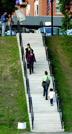 "The new staircase between Patriot's Way and Young's Field served plenty of foot traffic Saturday during the Village Center for the Arts' inaugural ""Paint the People"" art festival at Young's Field in New Milford. June 9, 2012 Photo: Norm Cummings"