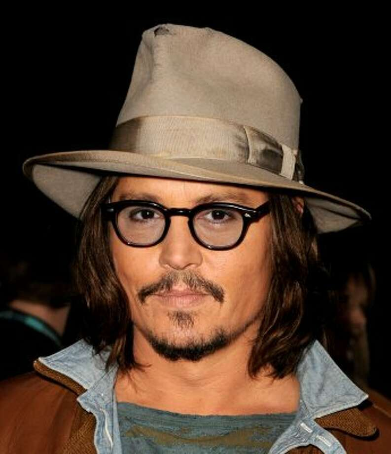 Johnny Depp's kid will have to rebel by not being the most beautiful man on the planet.  (Kevin Winter / Getty Images)