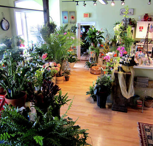 Ruth Chase Flowers has moved its business to the iconic former firehouse building on Church Street in New Milford. June 2012 Photo: Norm Cummings