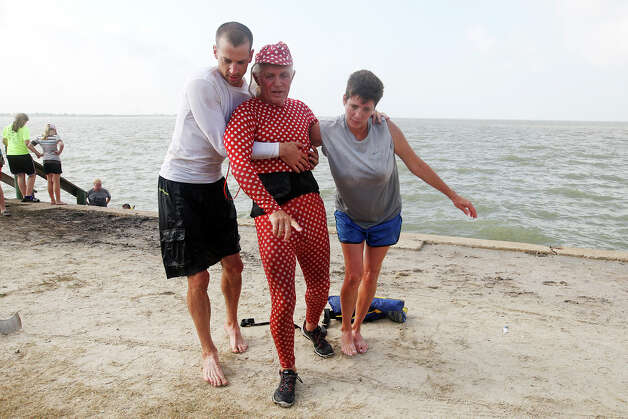Bob Vincent, 69, center, gets help after finishing the 2012 Texas Water Safari in a two-men canoe, Monday, June 11, 2012. The race starts at Aquarena Springs in San Marcos and ends in Seadrift, Texas by the San Antonio Bay. Vincent and his partner,  John Bugge came in 11th overall. Helping Vincent are Chris Wheeler, left, and Dawn Bugge. Photo: Jerry Lara, San Antonio Express-News / © 2012 San Antonio Express-News