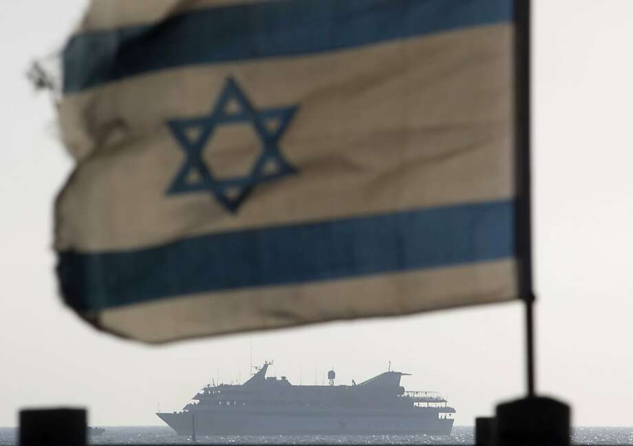 FILE - In this May 31, 2010 file photo, the Mavi Marmara ship, the lead boat of a flotilla headed to the Gaza Strip which was stormed by Israeli naval commandos in a predawn confrontation, sails into the port of Ashdod, Israel. A government report released Wednesday, June 13, 2012 harshly criticized Prime Minister Benjamin Netanyahu's decision-making as badly flawed as he oversaw a deadly Israeli naval raid on a Gaza-bound ship in May 2010. (AP Photo/Ariel Schalit, File) Photo: Ariel Schalit, Associated Press