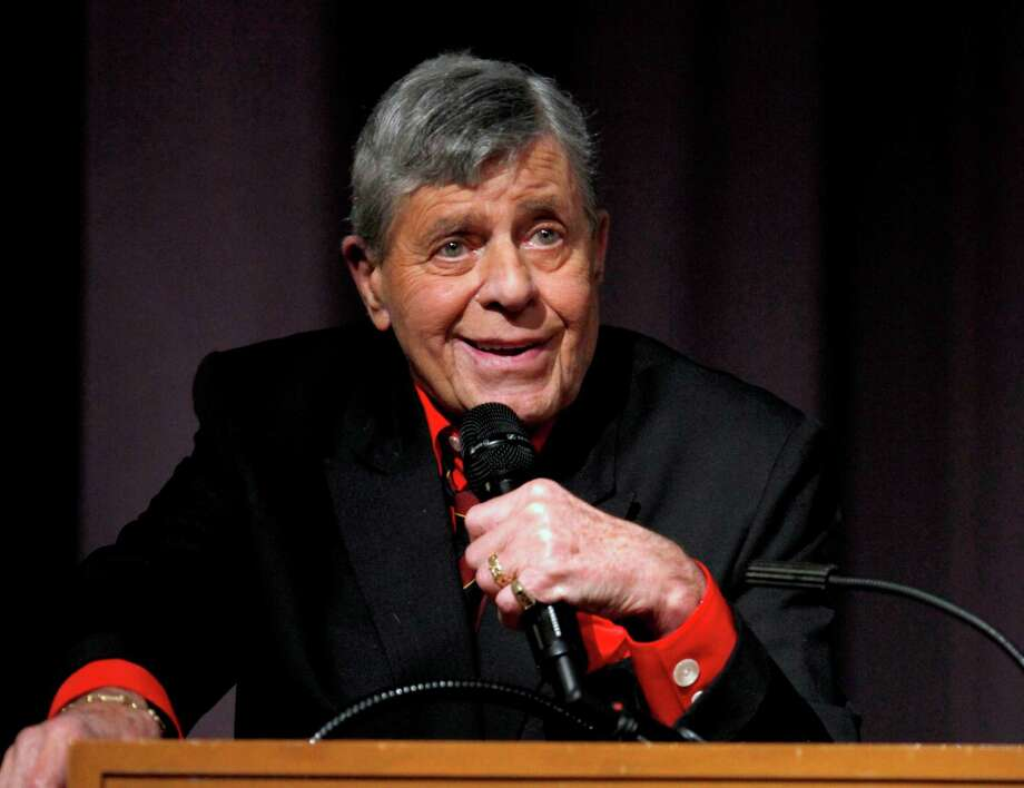 "FILE - In this Dec. 7, 2011 file photo released by Starz shows comedian Jerry Lewis speaking at the Encore Original premiere of ""Method to the Madness of Jerry Lewis"" in Los Angeles. The 86-year-old Lewis was hospitalized Tuesday, June 12, just before he was scheduled to receive an award and present another to Tom Cruise at the Friars Club Entertainment Icon Awards in New York. Publicist Candi Cazau says he should be released from the hospital sometime Wednesday. (AP Photo/Starz, Joe Kohen) Photo: Joe Kohen"