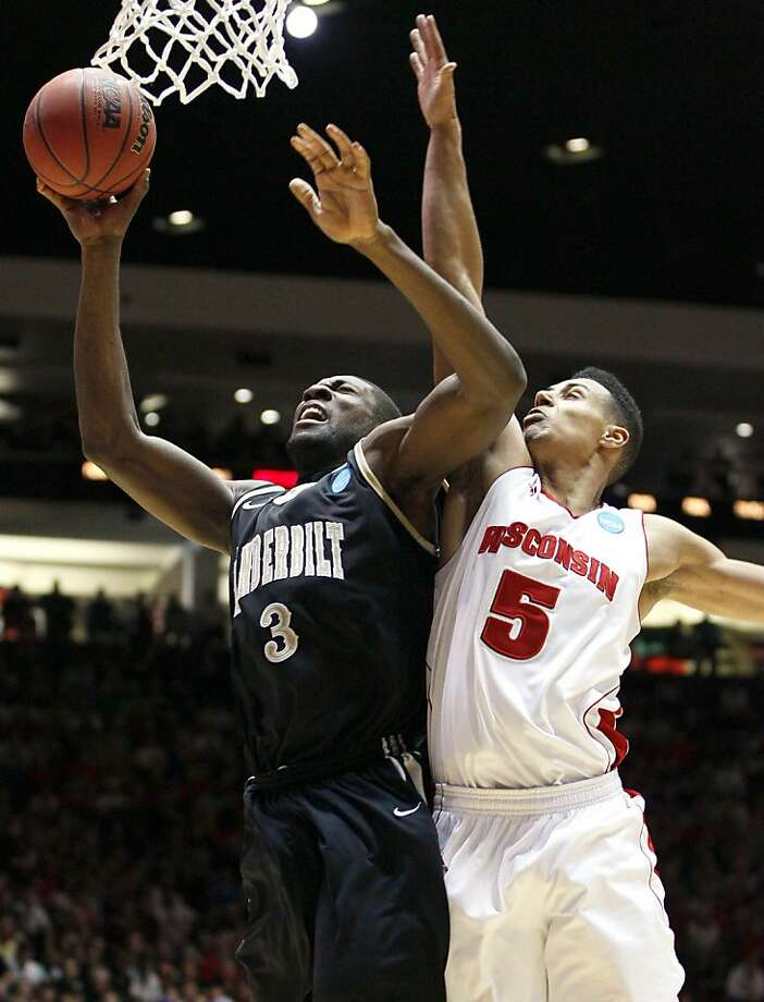 Vanderbilt center Festus Ezeli (3) shoots past Wisconsin forward Ryan Evans during the first half of an NCAA tournament third-round college basketball game on Saturday, March 17, 2012, in Albuquerque, N.M. (AP Photo/Matt York) Photo: Matt York, Associated Press