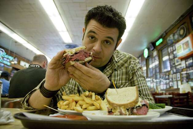 After a nasty and vicious spat on Instagram, the Travel Channel has pulled the plug on Adam Richman's upcoming series 'Man Finds Food,' the Washington Post reports. The former 'Man v. Food' star has since apologized for his comments. Photo: Frank Murray