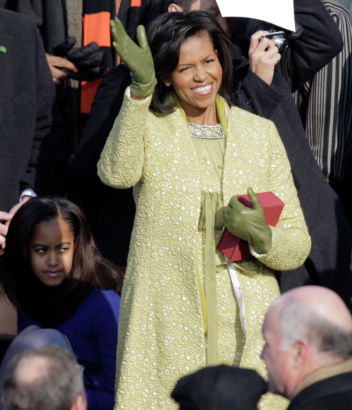 **FILE** This Jan. 20, 2009 file photo shows Michelle Obama as she arrives for the inauguration ceremony at the U.S. Capitol in Washington. The color of Michelle Obama's Isabel Toledo ensemble appeared to shift and change all day Tuesday, leading some observers wondering what to call the shade. (AP Photo/Jae C. Hong, FILE)