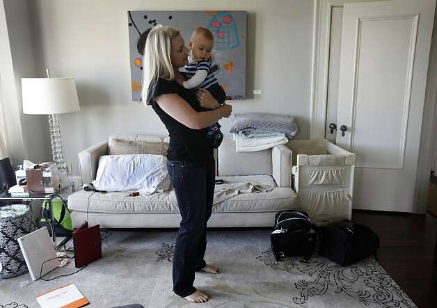 Bobbi Clemens holds her 6-month-old son Leonardo at their home in San Francisco, Calif. on Wednesday, June 13, 2012. Clemens and her family has tried unsuccessfully to win the city's lottery to convert their building from a tenancy-in-common to condos. Photo: Paul Chinn, The Chronicle