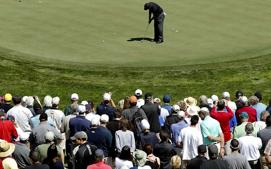 The gallery watches, as Phil Mickelson takes a few practice putts on the eighth green, as the second day of practice rounds continue during the United States Open Championship at the Olympic Club in San Francisco, Ca., on Tuesday June 12, 2012. Photo: Michael Macor, The Chronicle