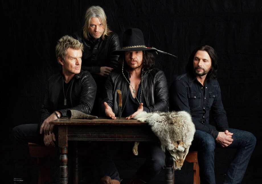 The Cult, which plays Tuesday night at the House of Blues, comprises Billy Duffy, from left, Chris Wyse, Ian Astbury and John Tempesta. Photo: Michael Lavine
