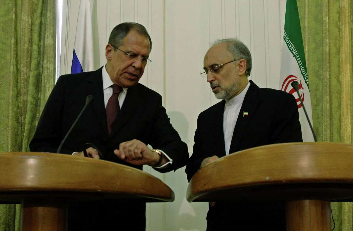 Russia's Foreign Minister Sergey Lavrov (left) and Iranian counterpart Ali Akbar Salehi say the U.S. and its allies are trying to destabilize Syria by arming President Bashar Assad's opposition with weapons.
