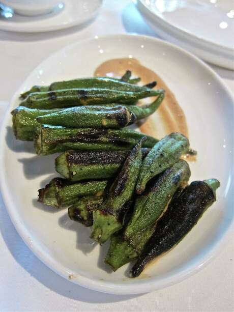 Haven's grilled okra with Tabasco-laced Avery Island sauce features a good char on its exterior while still remaining tender inside. Photo: Alison Cook