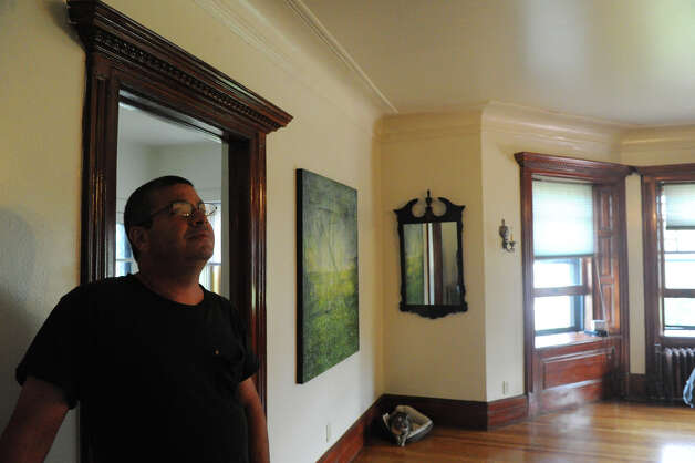 Brian Jordan photographed at the home his father, Edward Jordan, bought forty years ago on Hackett Circle in Stamford, Conn., June 13, 2012. It was divided into several apartments when he bought it, it still has tenants today. Photo: Keelin Daly / Stamford Advocate