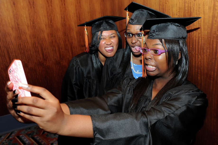 (From left) Early Care & Education students Zayna Rhodes, Cristol Thompson and Victoria Nelson pose for an iPhone photo prior to commencement exercises for the Bullard-Havens Technical High School Class of 2012, held at the Klein Memorial Auditorium, in Bridgeport, Conn. on Wednesday, June 13th, 2012. Photo: Ned Gerard / Connecticut Post