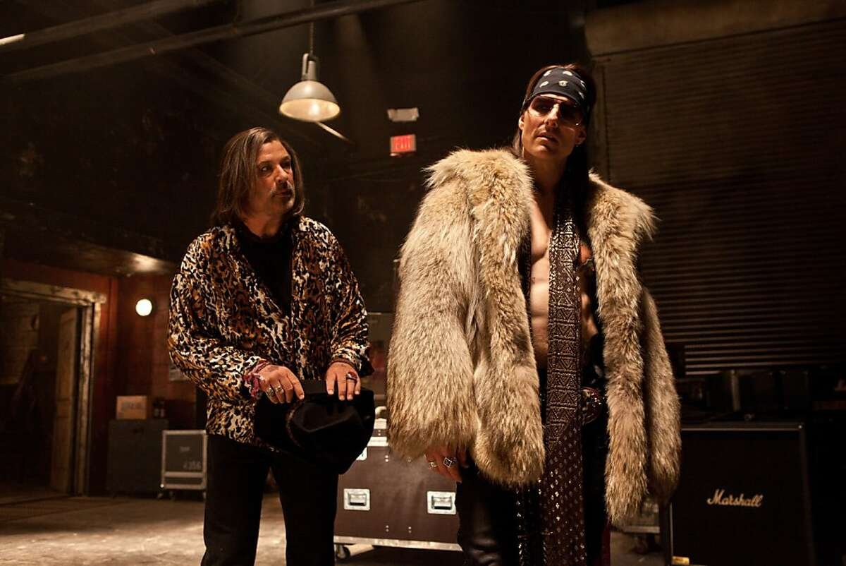 ROA-005392 (L-r) ALEC BALDWIN as Dennis Dupree and TOM CRUISE as Stacee Jaxx in New Line Cinema?•s rock musical ?'ROCK OF AGES,?