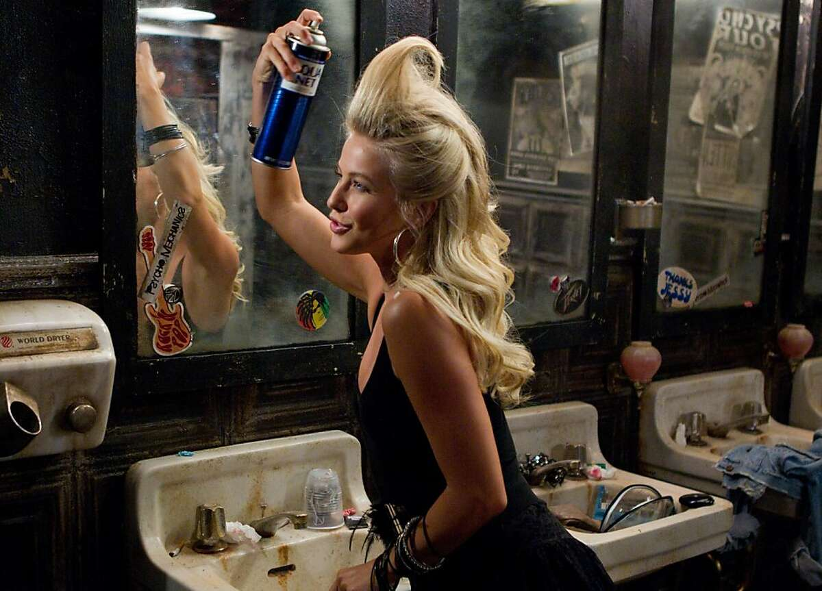 Tom Cruise lets his hair down, above, as metal head Stacee Jaxx, and Julianne Hough, left, perfects her 1980s do as singer Sherrie in