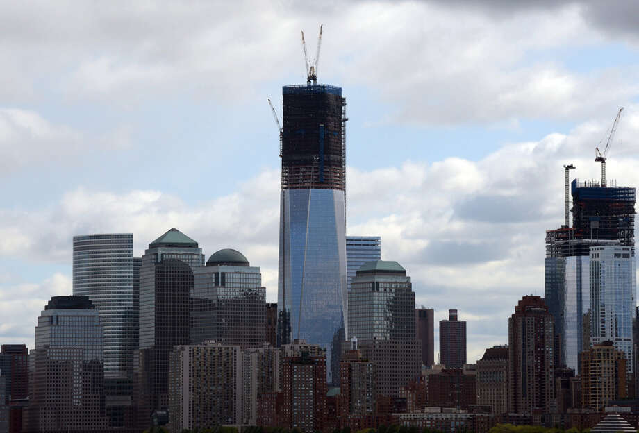 One World Trade Center became the tallest building in New York on April 30. The building, also known as Freedom Tower, is set to be 1,776 feet when completed, making it the tallest in the United States, although there's some question about whether the change from a sculptural sheath of interlocking fiberglass panels around the 400-foot rooftop mast to an exposed latticework structure will cause the spire not to count toward the building's height. The question doesn't impact this ranking, because the building in the next spot remains the country's tallest, at least for the moment. Photo: DON EMMERT/AFP, AFP/Getty Images / 2012 Getty Images