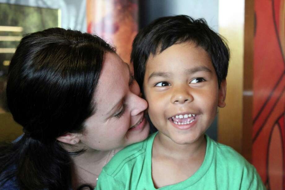 (RNS1-jun13) Becky Morlock with her son Kyle, who she adopted from India.  He was just two days old when his birth mother surrendered him as she was discharged from a hospital in the foothills of the Himalayas.  For use with RNS-MISSIONARY-MOM, transmitted on June 13, 2012, RNS photo courtesy Becky Morlock. Photo: RNS Photo Courtesy Becky Morlock