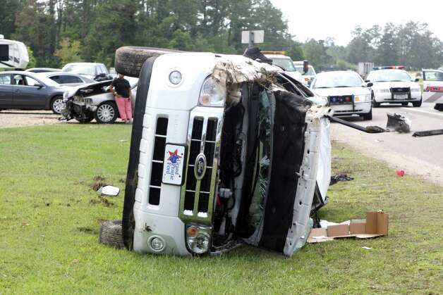 Three persons were injured in a two-vehicle accident oh Hwy. 69 in Kountze Wednesday afternoon. A 2010 Ford Explorer rolled multiple times after being hit by a late model Lincoln Town Car. Photo: David Lisenby, HCN_6-13 Wreck