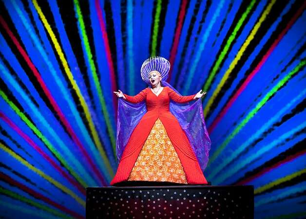 "The Queen of the Night (Albina Shagimuratova) is surrounded by a colorful animated projection during the production of ""The Magic Flute"". The San Francisco Opera presents a new production Mozart's ""The Magic Flute,"" which features over-the-top characters and projected animated sets. Photo: Kevin Johnson, The Chronicle"