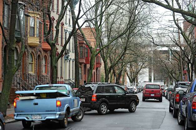 A car parks along Lancaster St. Friday Jan. 27, 2012 in Albany, N.Y.  Albany's Common Council is ready to set a start date on the creation of a long-desired parking permit system in Albany. (Lori Van Buren / Times Union archive) Photo: Lori Van Buren / 00016247A