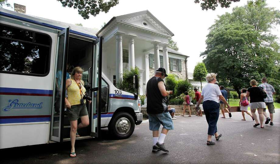 FILE -- This  Aug. 2010 photo shows tourists arriving at Graceland, Elvis Presley's home in Memphis, Tenn. Graceland opened for tours on June 7, 1982. They sold out all 3,024 tickets on the first day and didn't look back, forever changing the Memphis tourist landscape while keeping Elvis and his legend alive.(AP Photo/Mark Humphrey) Photo: Mark Humphrey