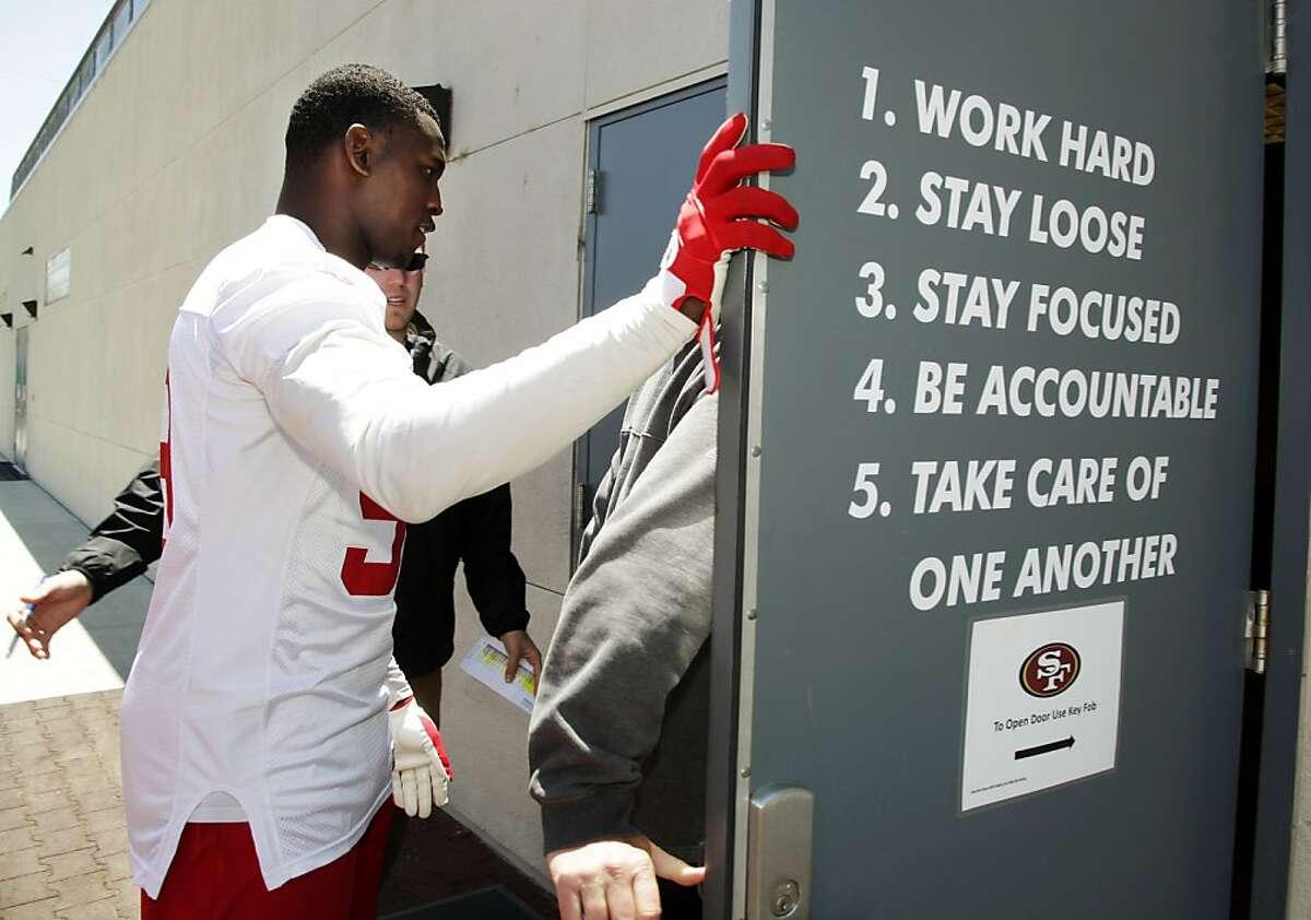 San Francisco 49ers linebacker Aldon Smith walks into the locker room after NFL football practice at the team's training facility in Santa Clara, Calif., Tuesday, June 5, 2012. (AP Photo/Paul Sakuma)