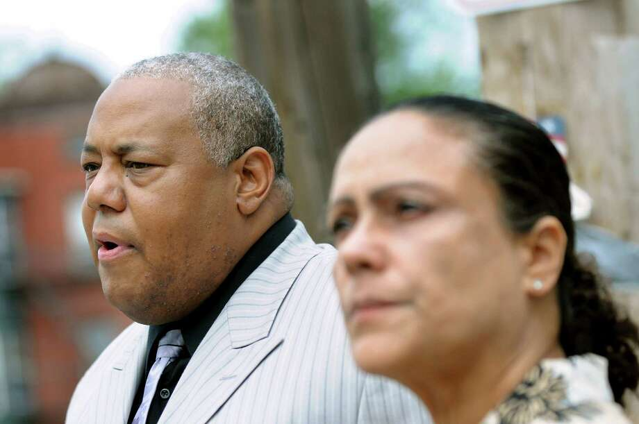 Ted Ward, NAACP president Schenectady chapter, left, speaks during a news conference on Thursday, Sept. 1, 2011, in Schenectady, N.Y. Ivette Cedres, right, is the mother of Luis Rivera, whom Schenectady police shot 14 times near the intersection of State and Grove streets. (Cindy Schultz / Times Union) Photo: Cindy Schultz / 00014485A